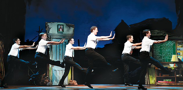 The Book of Mormon Rowan Witt as Elder McKinley and company - photo by Jeff Busby