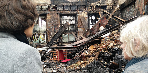 Caitlin Dullard and Liz Jones survey the aftermath of the fire at La Mama