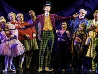 Paul Slade Smith as Willy Wonka and the Cast of Charlie and the Chocolate Factory