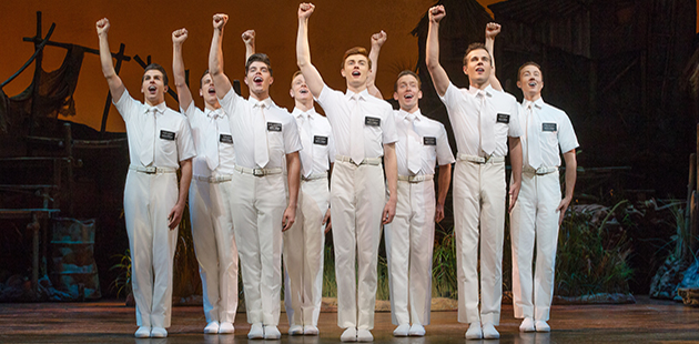 THE BOOK OF MORMON Joel Granger and Ensemble - photo by Jeff Busby