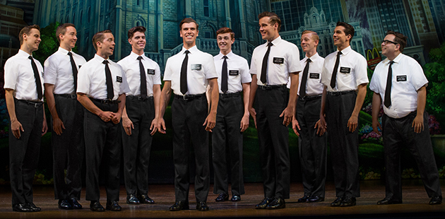 Blake Bowden (centre), Nyk Bielak (far right) and ensemble in The Book of Mormon - photo by Jeff Busby