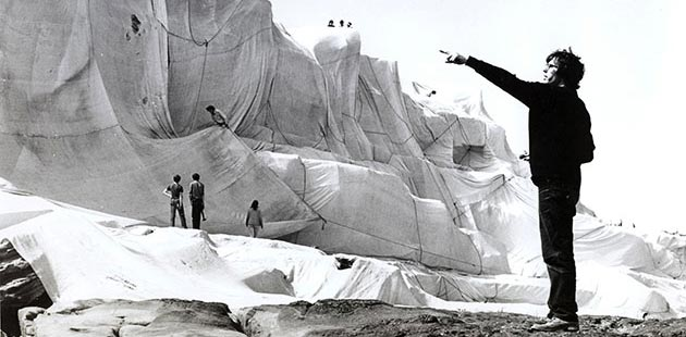 Christo directs workers and volunteers to create Wrapped Coast - One Million Square Feet, Little Bay, Sydney, Australia (1968 - 69) - photo by Harry Shunk