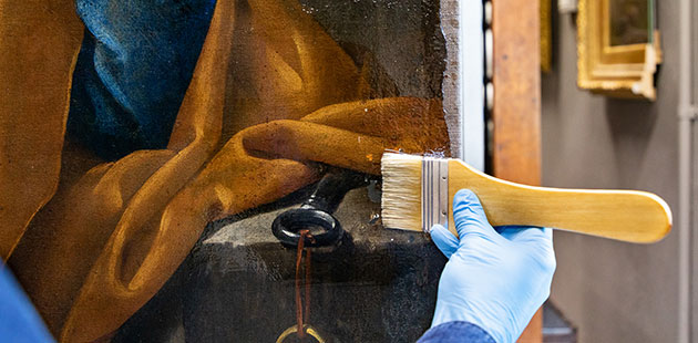 CSIRO Brush application of conservation grade resin onto a painting - photo by Selina Ou and Narelle Wilson NGV