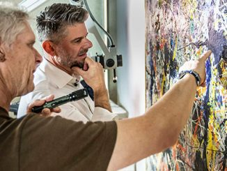 National-Gallery-of-Australia's-Director-Nick-Mitzevich-and-Senior-Conservator-of-Paintings,-David-Wise-analysing-Jackson-Pollock's-Blue-poles-1952