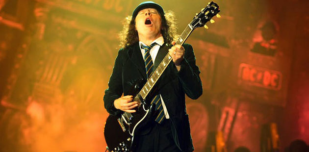 ACDC-Guitarist-Angus-Young-in-his-iconic-school-uniform-DAVID-CROSLING