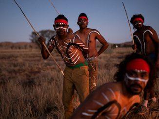 Jacob-Tiger-Kamarin-Mitakiki-Cameron-Young-and-Junior-Mitakiki-performing-inma-outside-Amata-Community-APY-Lands-SA-photo-by-Rohan-Thomson