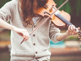 Violinist-playing-outdoors-photo-by-Clem-Onojeghuo-on-Unsplash