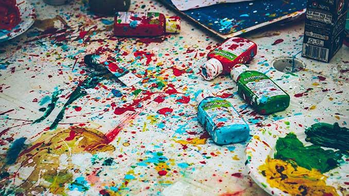 Splattered-paint-on-a-white-table-photoby-Ricardo-Viana-on-Unsplash